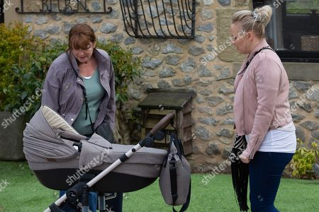 Emmerdale - Ep 9082 Thursday 24th June 2021 - 1st Ep Wendy Posner, as played by Susan Cookson, approaches Tracy Metcalfe, as played by Amy Walsh, to remind her of Frankie's jabs tomorrow, Tracy's uncomfortable at Wendy touching her baby with unwashed hands and rushes Frankie away.