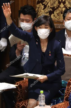 Stock Picture of Japanese Olympic Minister Tamayo Marukawa raises her hand to answer a question at Upper House's audit committee session at the National Diet in Tokyo on Monday, June 7, 2021.