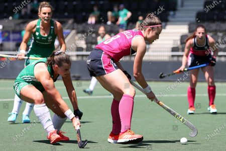 Lizzie Holden (L) of Ireland and Amy Costello of Scotland in action during the European Hockey Championship women pool A match between Ireland and Scotland at the Wagener Stadium in Amstelveen, Netherlands, 07 June 2021.