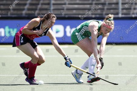 Bell McKenzie (L) of Scotland and Hannah Matthews of Ireland in action during the European Hockey Championship women pool A match between Ireland and Scotland at the Wagener Stadium in Amstelveen, Netherlands, 07 June 2021.