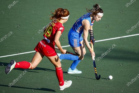Begona Garcia (L) of Spain in action against Eva de Goede (R) of the Netherlands during the European Hockey Championship women pool A match between Spain and the Netherlands at the Wagener Stadium in Amstelveen, Netherlands, 07 June 2021.