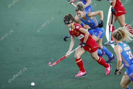 Carlota Petchame (L) of Spain in action against Maria Verschoor (C) of the Netherlands during the European Hockey Championship women pool A match between Spain and the Netherlands at the Wagener Stadium in Amstelveen, Netherlands, 07 June 2021.