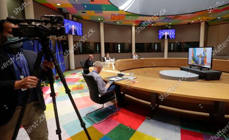 Mozambique's President Filipe Nyusi (R on screen) during a video meeting with European Council President Charles Michel (2-L) at the European Council building in Brussels, Belgium, 07 June 2021.