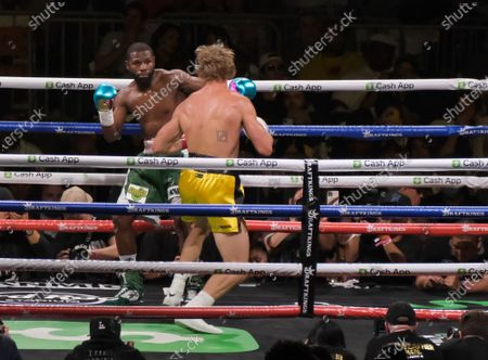 Floyd Mayweather Jr, 44 throws a left at Logan Paul, 26 in an exhibition fight at the Hard Rock Stadium