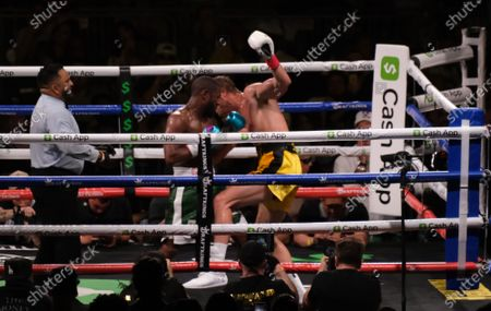 Floyd Mayweather Jr, 44 lifts Logan Paul, 26 off the ground in an exhibition fight at the Hard Rock Stadium
