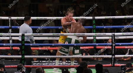 Floyd Mayweather Jr, 44 hits the body of Logan Paul, 26 in an exhibition fight at the Hard Rock Stadium
