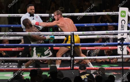 Floyd Mayweather Jr, 44 moves back from Logan Paul, 26 in an exhibition fight at the Hard Rock Stadium