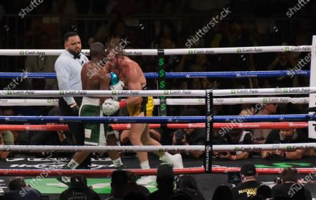 Floyd Mayweather Jr, 44 hits Logan Paul, 26 in the body in an exhibition fight at the Hard Rock Stadium