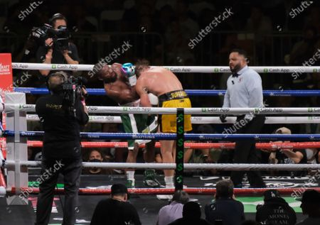 Floyd Mayweather Jr, 44 gets a head bunk Logan Paul, 26 in an exhibition fight at the Hard Rock Stadium