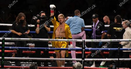 Logan Paul, 26 enters the arena before an exhibition fight with Floyd Mayweather Jr at the Hard Rock Stadium