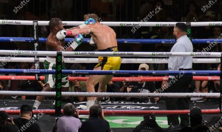 Floyd Mayweather Jr, 44 and Logan Paul, 26 throw punches at each other during an exhibition fight with at the Hard Rock Stadium