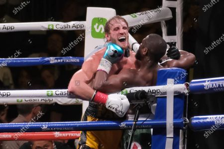Stock Image of Floyd Mayweather Jr, 44 hits Logan Paul, 26 in his chin during an exhibition fight with at the Hard Rock Stadium