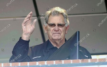Stock Photo of St. Louis Cardinals broadcaster Mike Shannon waves to the crowd from the KMOX Radio booth after the public address announcer told the fans that Shannon will retire after 50 years behind the microphone, during a game against the Cincinnati Reds at Busch Stadium in St. Louis
