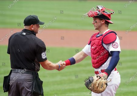 Stock Image of Home Plate Umpire Scott Berry greets St. Louis Cardinals catcher Andrew Knizner before the start of the game against the Cincinnati Reds at Busch Stadium in St. Louis