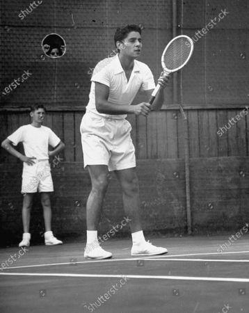 Tennis star Richard Alonzo Pancho Gonzalez, 21 year-old, waiting for service.