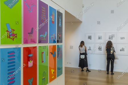 Works by Michael Craig-Martin - Sunny weather and London Gallery Weekend brings out plenty of visitors - Public viewing of the collection of the Editions sale at Pillips, London.