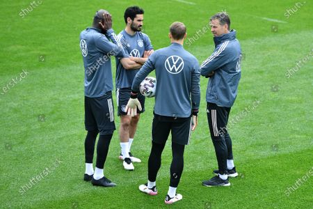 Stock Photo of From left to right: Antonio Rüdiger (Germany) - Ilkay Gündogan (Germany) - Manuel Neuer (Germany) - Oliver Bierhoff (Director National Teams and German Academy)