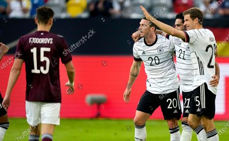 Germany's scorer Ilkay Gundogan, second right, and his teammates Robin Gosens, third right, and Thomas Mueller, right, celebrate their side's second goal during the international friendly soccer match between Germany and Latvia in Duesseldorf, Germany