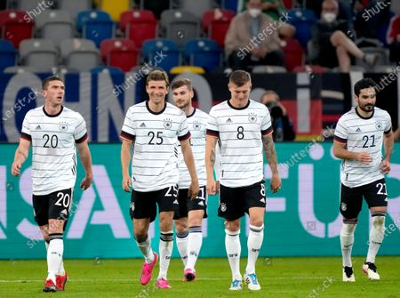 From left, Germany's players Robin Gosens, Thomas Mueller, Timo Werner, Toni Kroos and Ilkay Gundogan walk on the pitch during the international friendly soccer match between Germany and Latvia in Duesseldorf, Germany