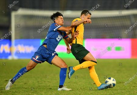 Trent Sainsbury (R) of Australia in action against Jui-Chieh Chen (L) of Taiwan during the Asian Qualifiers for the FIFA World Cup 2022 and AFC Asian Cup 2023 group B soccer match between Australia and Taiwan at Jaber Al-Ahmad International Stadium in Kuwait City, Kuwait, 07 June 2021.