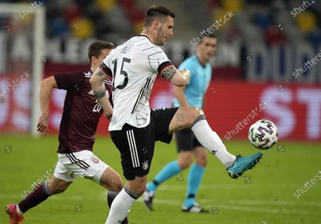 Stock Image of Germany's Niklas Suele controls the ball during the international friendly soccer match between Germany and Latvia in Duesseldorf, Germany