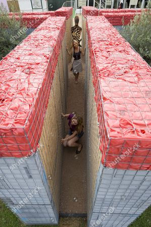 Stock Photo of Jules Sorby and Kate Manning in the Hearts and Minds Heat Sand Mines conceptual garden