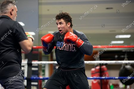 Boxing team member Richard Torrez Jr. spars with head coach Billy Walsh during a media day for the team in a gym located in a converted Macy's Department store, in Colorado Springs, Colo