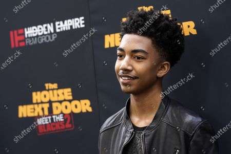 """Actor Miles Brown arrives at the premiere of the film """"The House Next Door: Meet The Blacks 2"""" at Regal L.A. Live, in Los Angeles"""