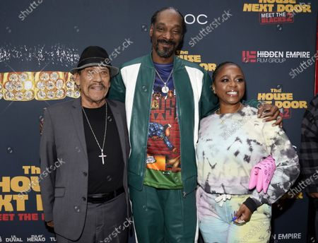 """Stock Picture of Snoop Dogg, center, a cast member in """"The House Next Door: Meet The Blacks 2,"""" poses with his wife, Shante Broadus, right, and fellow cast member Danny Trejo at the premiere of the film at Regal L.A. Live, in Los Angeles"""
