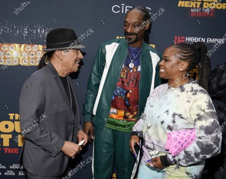 """Danny Trejo, left, a cast member in """"The House Next Door: Meet The Blacks 2,"""" mingles with fellow cast member Snoop Dogg and his wife, Shante Broadus, at the premiere of the film at Regal L.A. Live, in Los Angeles"""