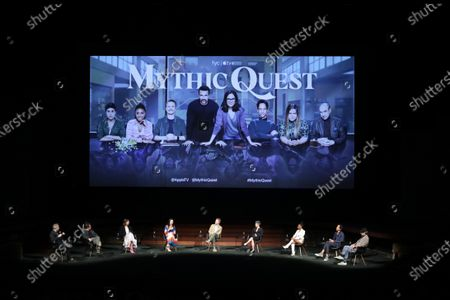 """Stock Image of Moderator Michael Schneider, Rob McElhenney, Creator/Writer/Executive Producer, Megan Ganz, Creator/Executive Producer, Charlotte Nicdao, David Hornsby, Writer/Executive Producer, Ashly Burch, Writer, Imani Hakim, Danny Pudi and F. Murray Abraham of """"Mythic Quest"""" at Apple's FYC Summer Screening Series at The Ford Ampitheater. Season two of """"Mythic Quest"""" is streaming now on Apple TV+."""