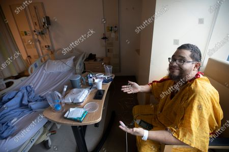 Gilbert Torres, age 30, sitting up next to his bed at Martin Luther King, Jr. Community Hospital (MLKCH) on Feb. 1, 2021 in the Willowbrook neighborhood of southern Los Angeles County, CA. Gilbert Torres is a covid positive and he was placed on a ventilator. He is better and the ventilator was removed. He will be going home soon. (