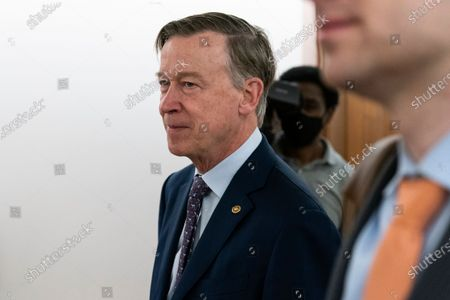 Sen. John Hickenlooper, D-Colo., arrives for a hearing on Capitol Hill, in Washington
