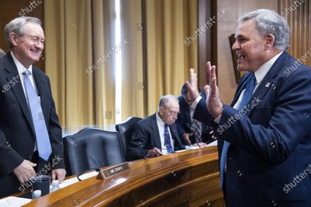 Commissioner of the Internal Revenue Service (IRS) Charles Rettig (R), greets ranking member Sen. Mike Crapo, R-Idaho, before testifying about the proposed IRS budget request for fiscal year 2022 during a Senate Finance Committee hearing at the U.S. Capitol in Washington DC, on Tuesday, June 8, 2021.