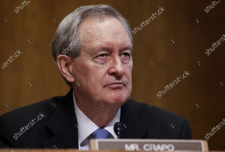 Sen. Mike Crapo (R-ID), listens as Commissioner of the Internal Revenue Service (IRS) Charles Rettig testifies about the proposed IRS budget request for fiscal year 2022 during a Senate Finance Committee hearing at the U.S. Capitol in Washington DC, on Tuesday, June 8, 2021.