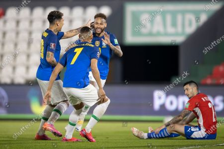 Neymar of Brazil celebrates his goal with Roberto Firmino and Richarlison in the 4th minute 0-1; Defensores del Chaco Stadium, Asuncion, Paraguay; World Cup 2022 qualifiers; Paraguay versus Brazil.