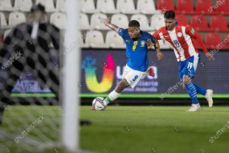 Santiago Arzamendia of Paraguay and Gabriel Jesus of Brazil; Defensores del Chaco Stadium, Asuncion, Paraguay; World Cup football 2022 qualifiers; Paraguay versus Brazil.