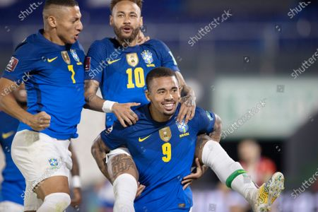 Neymar of Brazil celebrates his goal with Gabriel Jesus and Richarlison in the 4th minute 0-1; Defensores del Chaco Stadium, Asuncion, Paraguay; Qatar 2022 qualifiers; Paraguay versus Brazil.