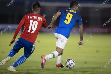 Gabriel Jesus of Brazil breaks away from Arzamendia of Paraguay; Defensores del Chaco Stadium, Asuncion, Paraguay; World Cup football 2022 qualifiers; Paraguay versus Brazil.