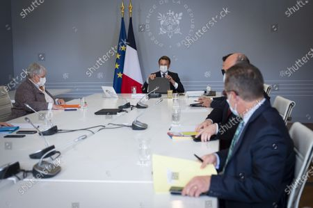 Jacqueline Gourault, Minister of Territorial Cohesion and Emmanuel Macron, President of the Republic, during a visio conference with the elected officials concerned by the reconstruction of the vallees of the Roya, Tinee and Vesubia.