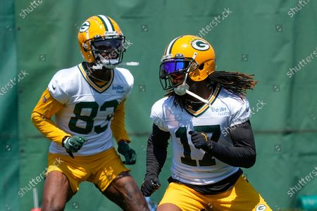 Green Bay Packers' Davante Adams and Marquez Valdes-Scantling run a drill during an NFL football minicamp, in Green Bay, Wis