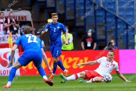 Poland's Piotr Zielinski (R) and Iceland's Jon Dadi Bodvarsson (L) and Alfons Sampsted (C) in action during the International Friendly soccer match between Poland and Iceland in Poznan, west-central Poland, 08 June 2021.