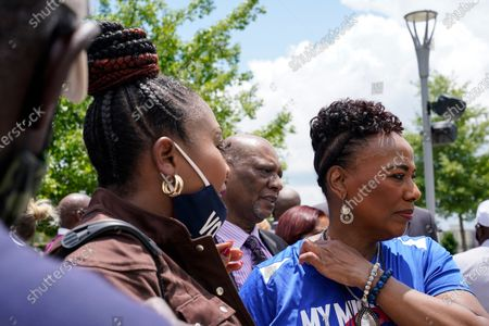 Bernice King, right, daughter of slain civil rights leader Rev. Martin Luther King Jr., speaks with other faith leaders after a voting rights rally at Liberty Plaza near the Georgia State Capitol, in Atlanta