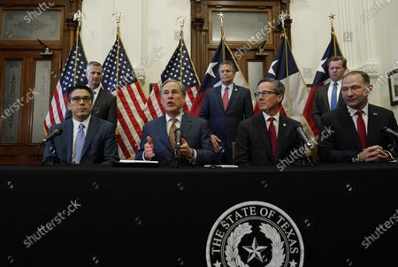 Texas Gov. Greg Abbott, seated second from left, speaks at a news conference where he signed two energy related bills, in Austin, Texas. Abbot signed legislation into law to reform the Electric Reliability Council of Texas (ERCOT) and weatherize and improve the reliability of the state's power grid