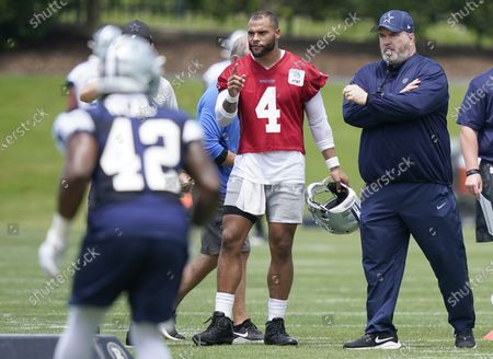 Dallas Cowboys quarterback Dak Prescott (4) stands with head coach Mike McCarthy as they watch drills during an NFL football team practice, in Frisco, Texas