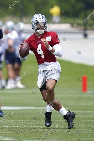 Dallas Cowboys quarterback Dak Prescott looks to pass during an NFL football team practice, in Frisco, Texas