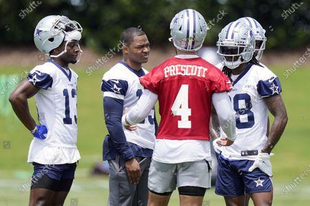 Dallas Cowboys quarterback Dak Prescott (4) speaks with wide receivers Michael Gallup (13), Amari Cooper (19) and CeeDee Lamb (88) during an NFL football team practice, in Frisco, Texas