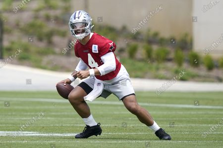 Stock Picture of Dallas Cowboys quarterback Dak Prescott looks to pass during an NFL football team practice, in Frisco, Texas