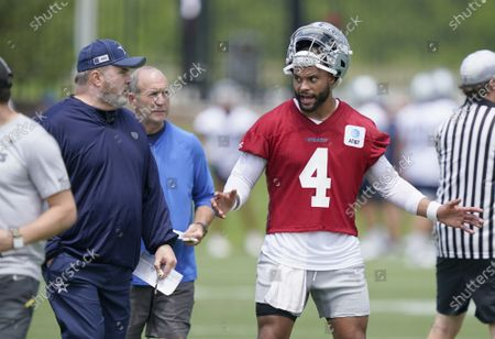 Stock Image of Dallas Cowboys quarterback Dak Prescott (4) talks with head coach Mike McCarthy as they watch drills during an NFL football team practice, in Frisco, Texas