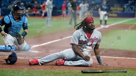 Stock Image of Washington Nationals' Josh Bell (19) reacts after being tagged out by Tampa Bay Rays catcher Mike Zunino while trying to score on a single by Josh Harrison during the seventh inning of a baseball game, in St. Petersburg, Fla